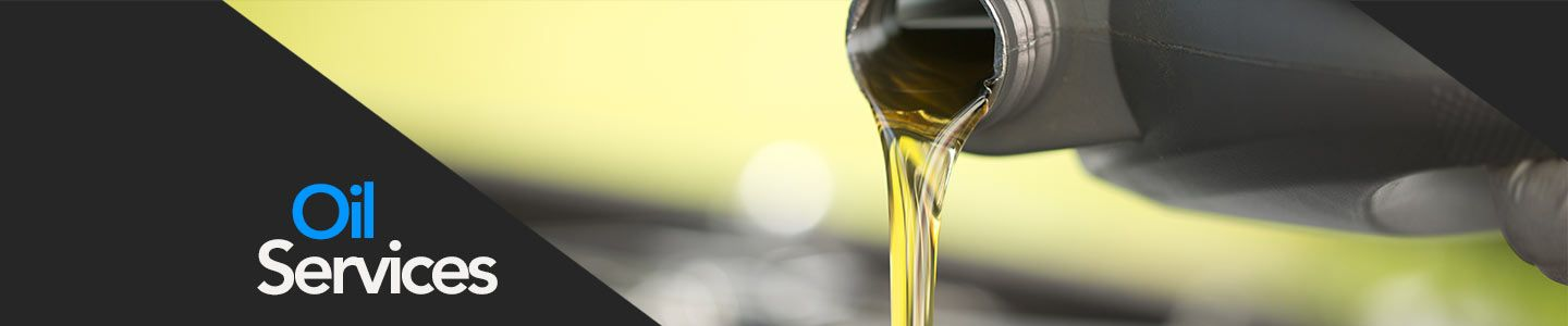 Honda of Ocala oil services, mechanic pouring oil into vehicle