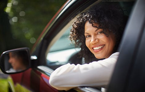Female driver looking outside of car window