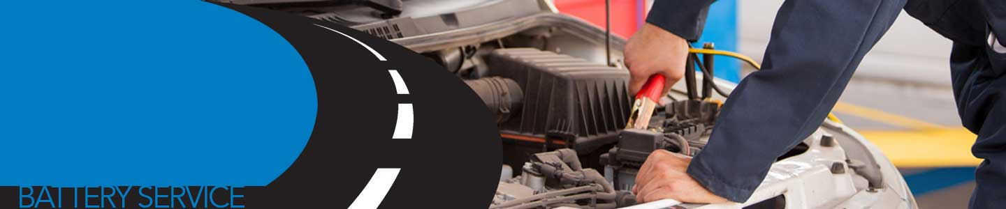Car Mechanic performing battery service on vehicle