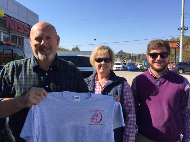Keith posing with one of our donated Tshirts at Woody Folsom Nissan of Vidalia
