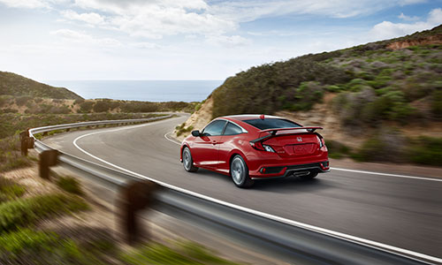 2018 Honda Civic Coupe on a winding road