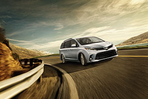 2018 Toyota Sienna driving around a mountain curve