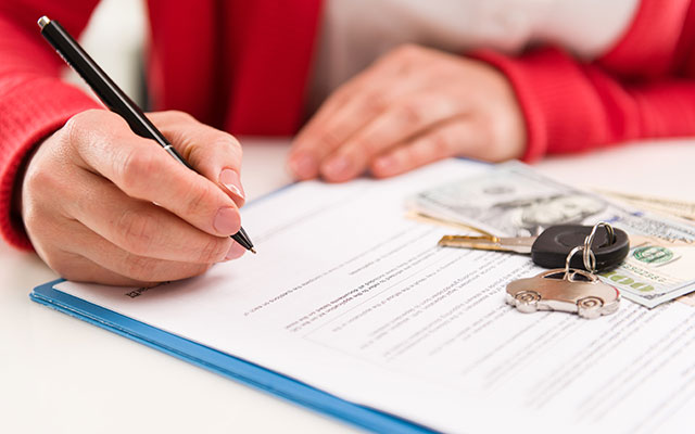 Woman signing financial paperwork