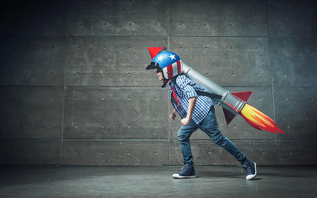 Child with toy rocket pack strapped to his back