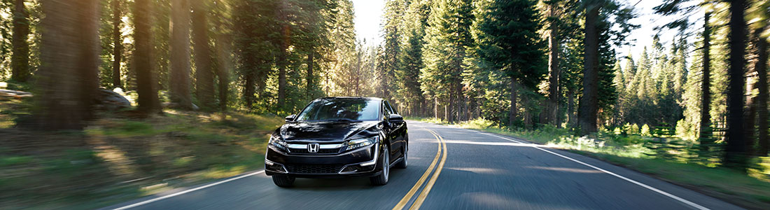 2018 Honda Clarity driving through the woods