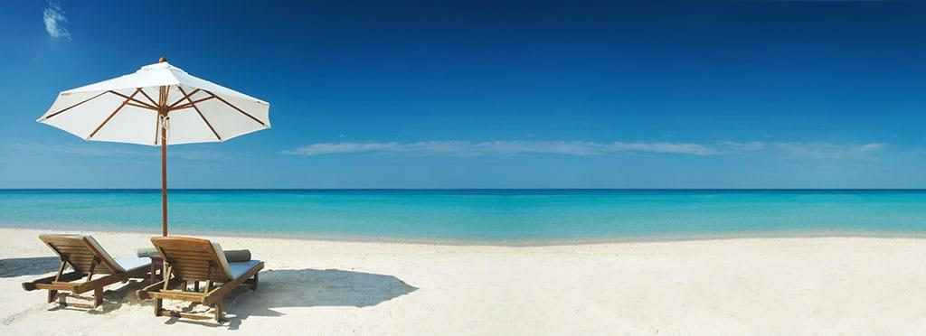 Tropical beach, chairs, and umbrella