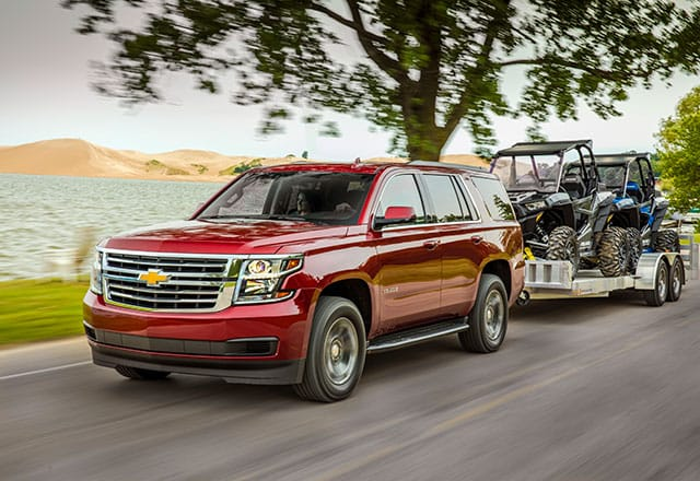 2018 Chevrolet Tahoe towing two ATVs on a trailer