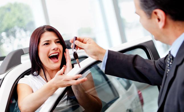 Salesman handing over keys to happy customer