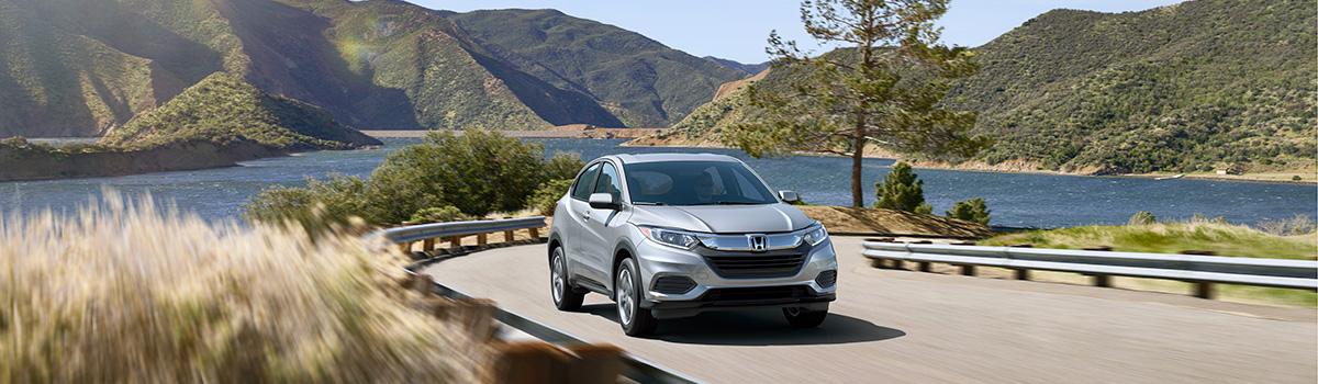2019 Honda HR-V driving by lake