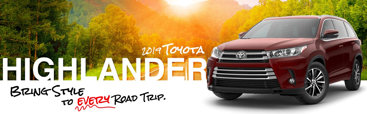 2019 red Exterior Highlander On Road at Carlock Toyota of Tupelo