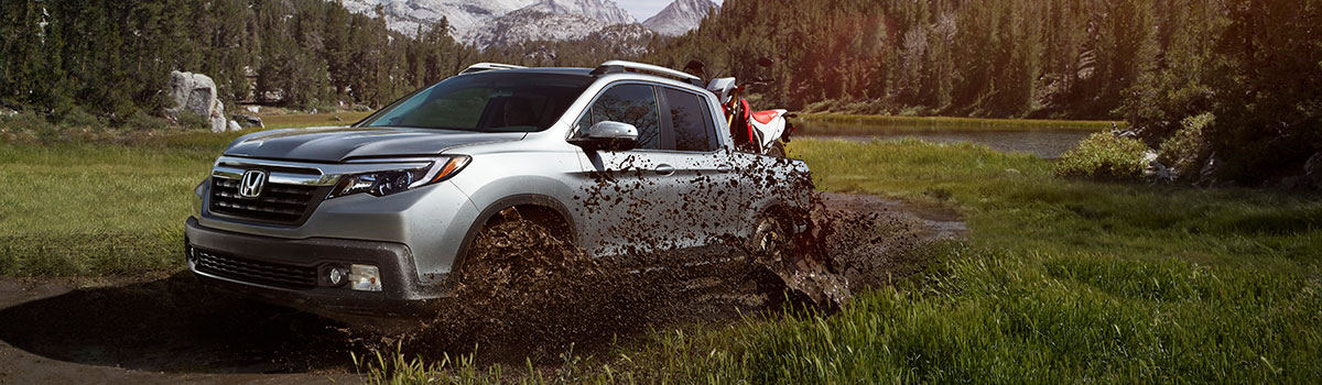 2019 Honda Ridgeline driving through mud