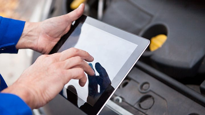 Technician holding tablet computer
