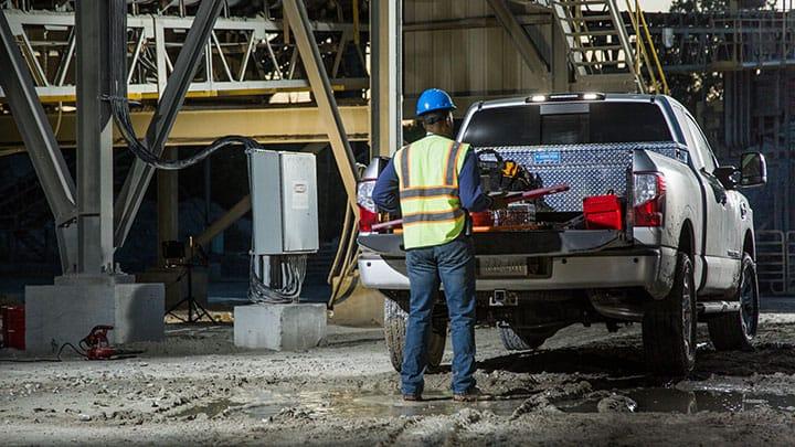 Construction worker loading Titan XD