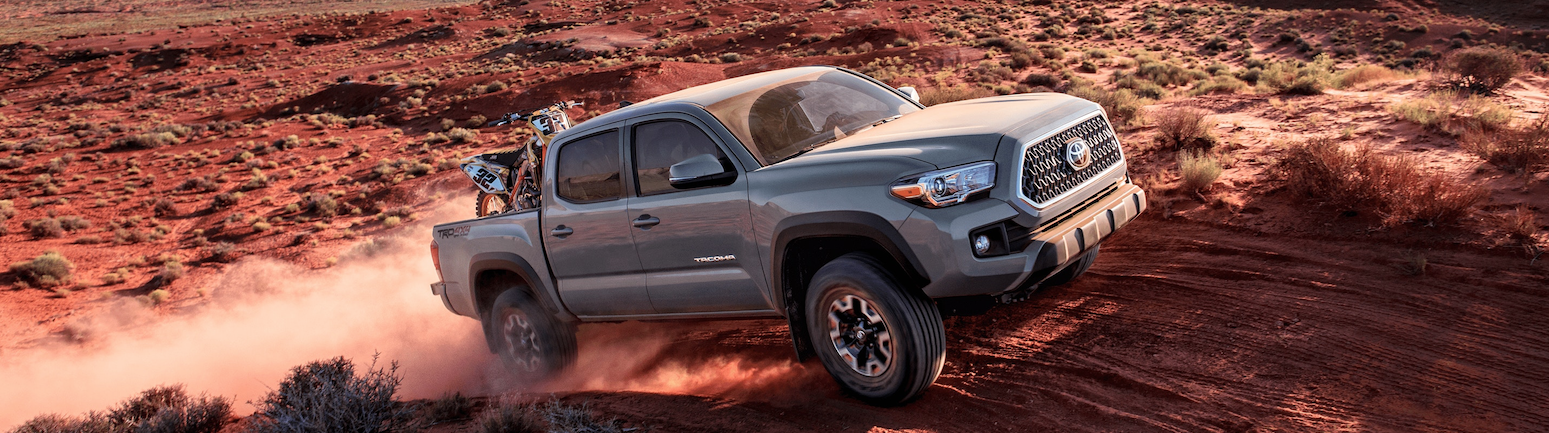 2019 Red Exterior Tacoma On Road at Toyota of El Cajon