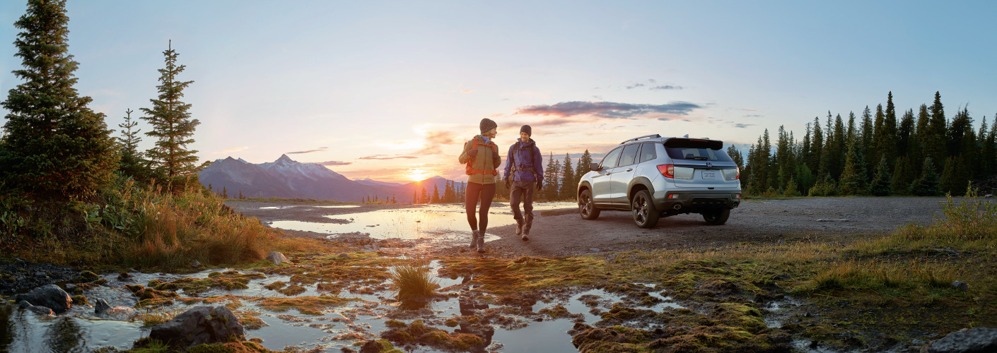 Silver 2019 Honda Passport near lake