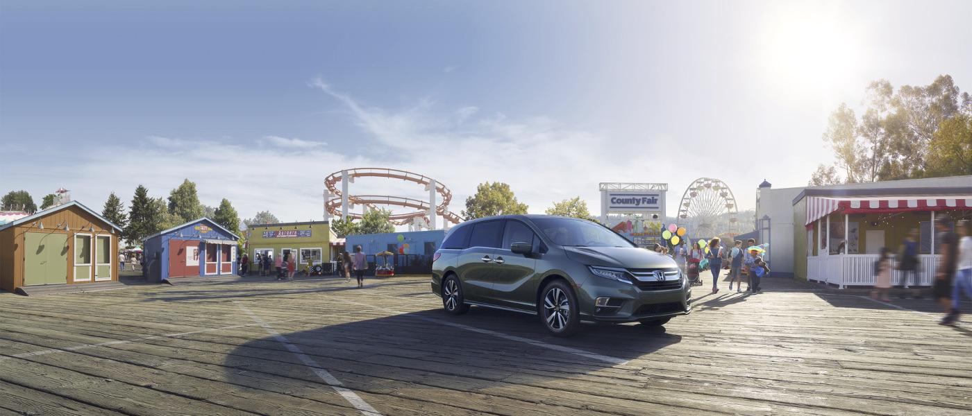 Green 2019 Honda Odyssey in amusement park