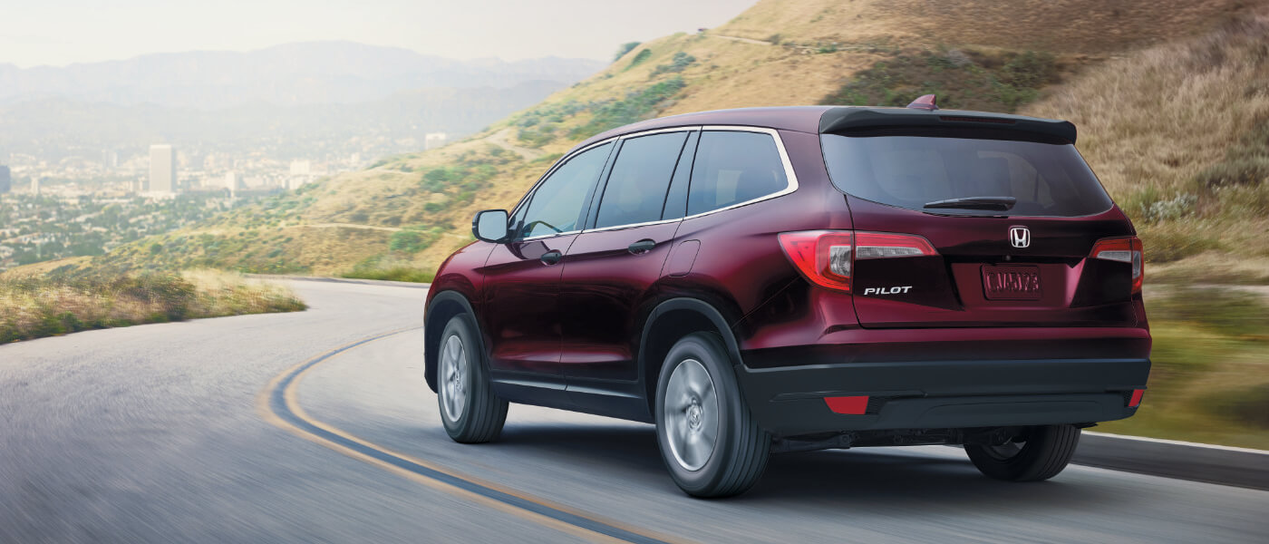 Red 2019 Honda Pilot on road