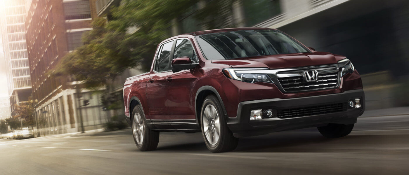Red 2019 Honda Ridgeline on road