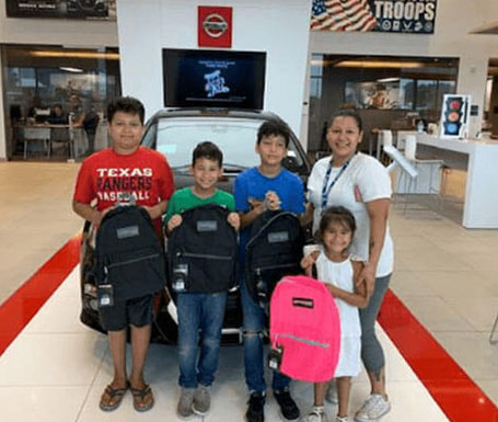 woman with 4 children with new backpacks