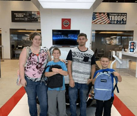 family, 2 kids with new backpacks