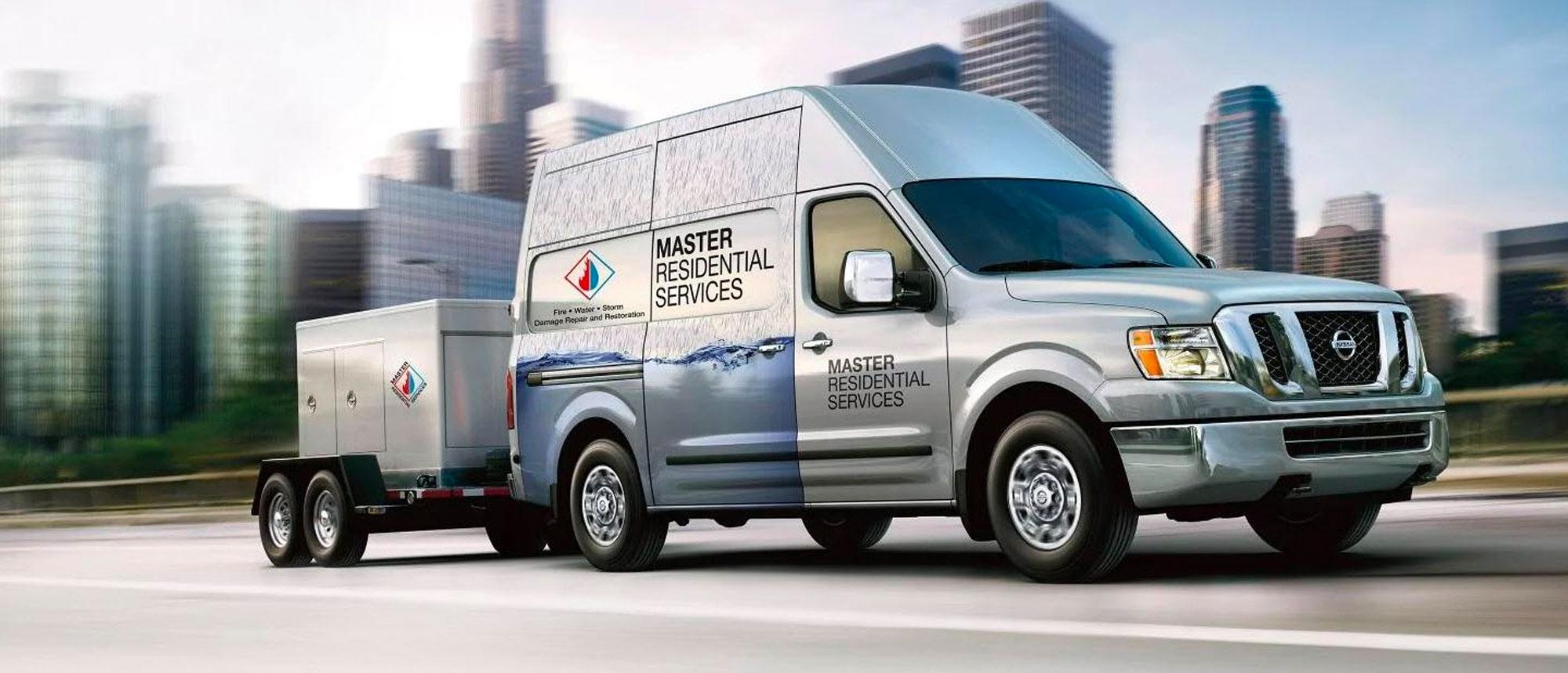 Silver Nissan Commercial Van in Urban Setting