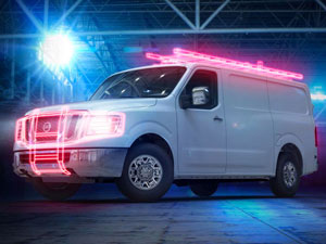White Nissan Commercial Van with accent lighting to highlight commercial vehicle accessories