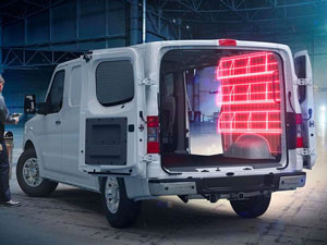 White Nissan Commercial Cargo Van with highlighted storage racks to show cargo management solutions