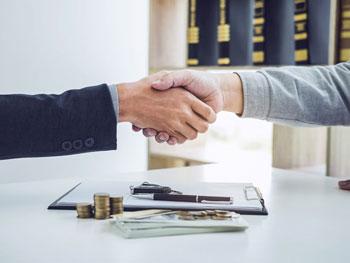 Handshake over paperwork