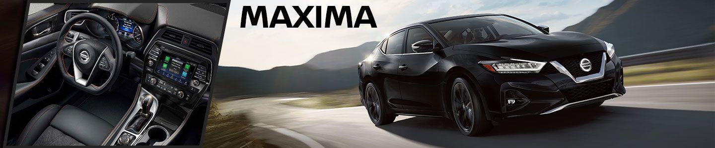 black 2020 Nissan Maxima driving outside, interior