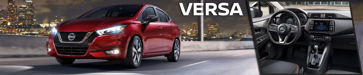 red 2020 Versa driving through city, interior