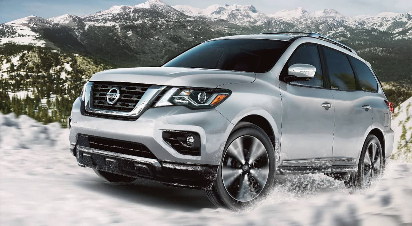 2020 Nissan Pathfinder in Silver driving through the snow