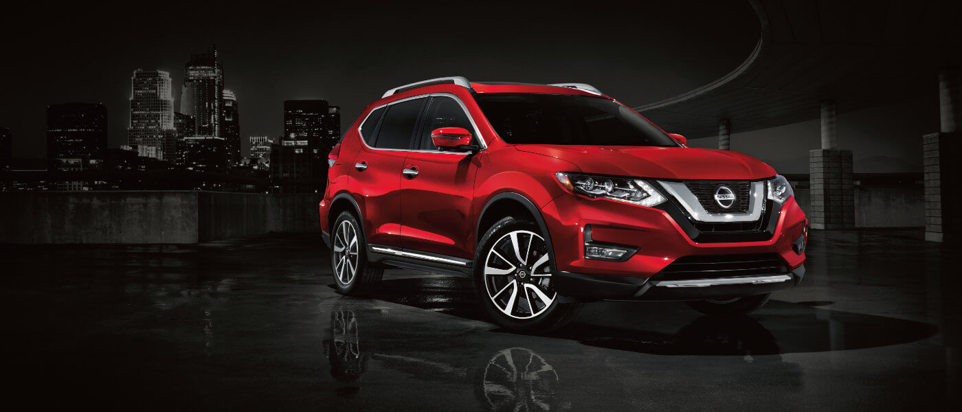 2020 Nissan Rogue driving in city at night
