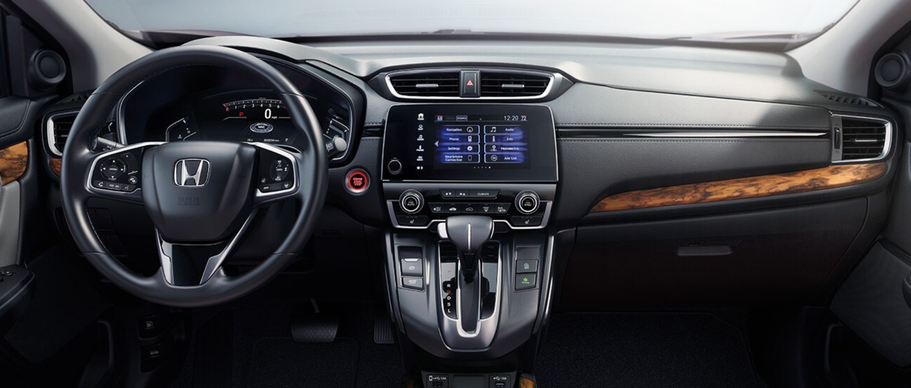 The interior of a 2020 Honda CR-V Hybrid with wood grain trim. Available now at Pacific Honda of San Diego