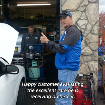 happy customer evaluating the excellent care he is receiving on his car.