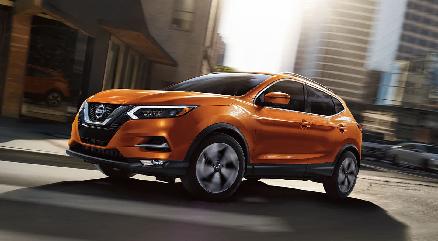 2020 Nissan Rogue Sport in Silver driving through the snow