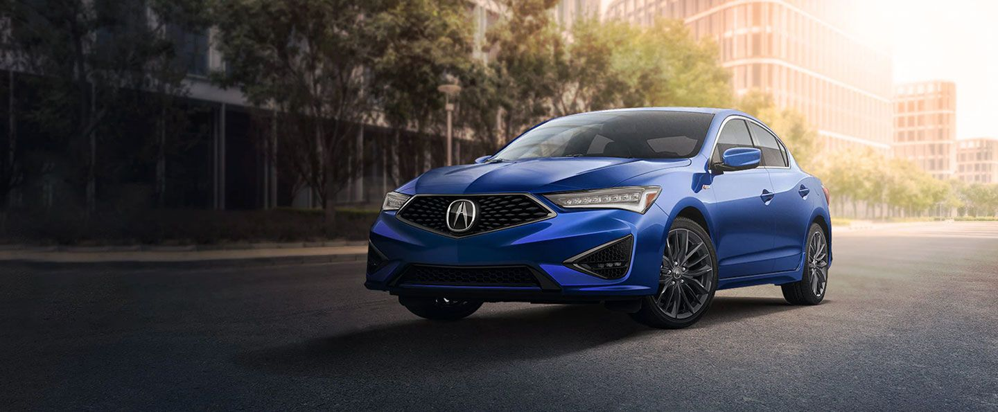 blue 2020 Acura ILX on city street