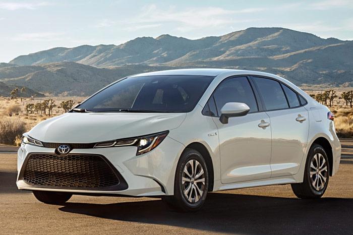 Front-left shot of white Toyota Corolla Hybrid