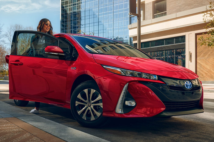 Front end of red Toyota Prius Prime