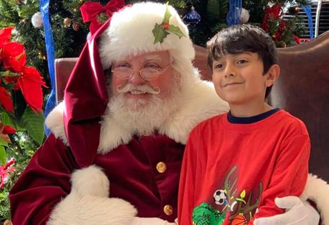 Happy Santa and brunette boy