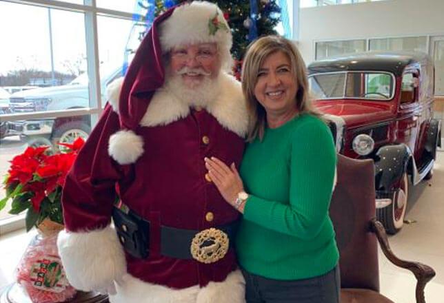 Santa w/ lady in green shirt