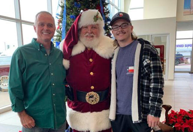 Santa smiling with two guys