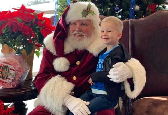 Santa and little blonde boy
