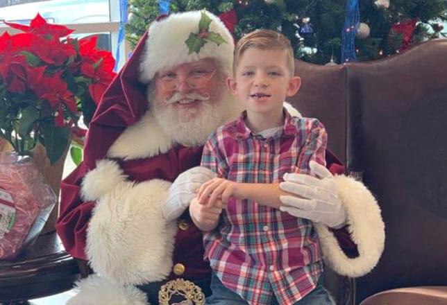 Santa and cute boy missing front teeth