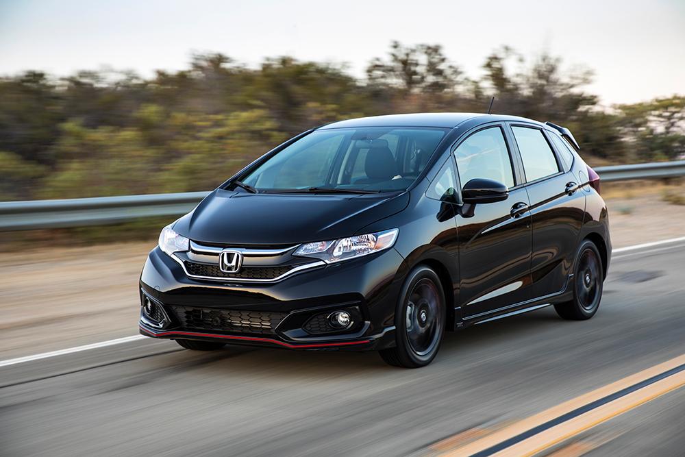 Black 2020 Honda Fit on highway