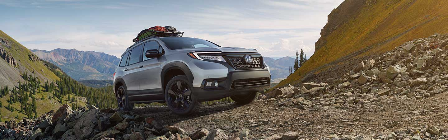 2020 Honda Passport driving over hill
