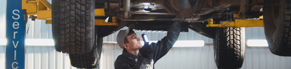 Mechanic Working Under Vehicle