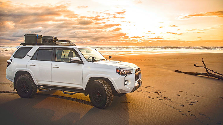 An SUV on a beach in Washington, State. PHOTO by Kyle Grozelle.