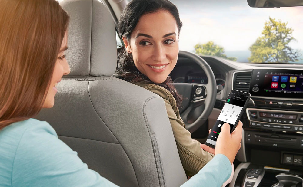 Woman and girl driving inside Honda Pilot