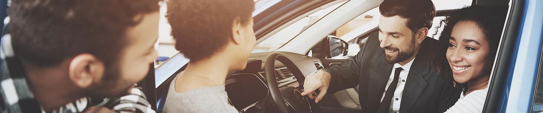 Salesman assist family choosing a new car