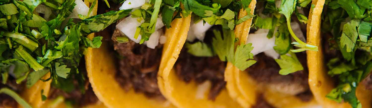 National Taco Day, picture of several tacos. Photo by Jeswin Thomas